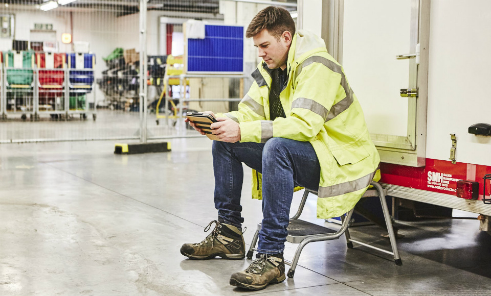 Site auditor looking at data on an ipad while sitting down